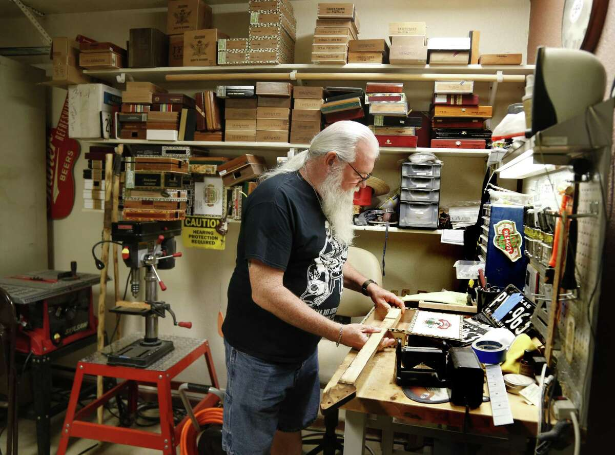 Rehfeld's garage workshop is filled with power tools, smells of wood glue and sawdust and is lined with shelves of empty wooden cigar boxes just waiting to make sweet, sweet music.