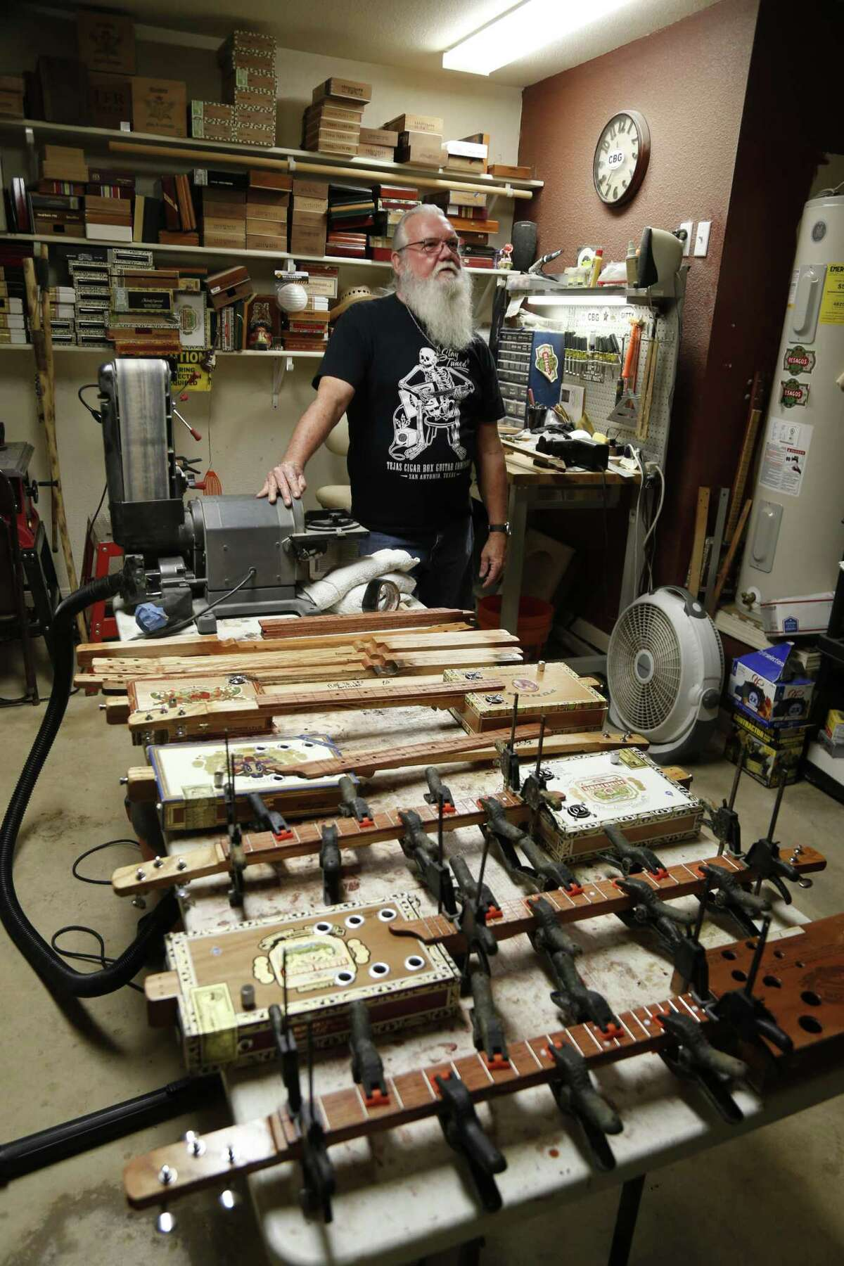 Rehfeld is busy making cigar box guitars in preparation for the upcoming Texas Folklife Festival. He can make five or six guitars a week, each one taking 10 to 12 hours to complete - although he makes them in batches on a sort of homemade production line.