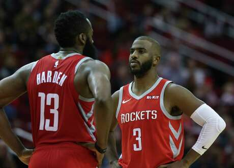 Houston Rockets players James Harden (13) and Chris Paul (3) have a conversation during the fourth quarter of the NBA game at Toyota Center on Wednesday, Nov. 21, 2018, in Houston. The Houston Rockets defeated the Detroit Pistons 126-124.