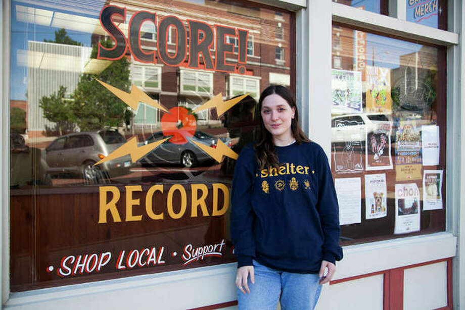 Rebecca Peterson stands outside of her music store, Score Records, at 210 Market Street, Alton. Peterson started the business a year ago when she saw the small commercial space next to The Grand Theater was available for rent. The store celebrates its one-year anniversary Saturday with Score Fest 2019 at the Jacoby Arts Center, an all-ages concert featuring seven different bands and musicians. Photo: Jeanie Stephens | The Telegraph