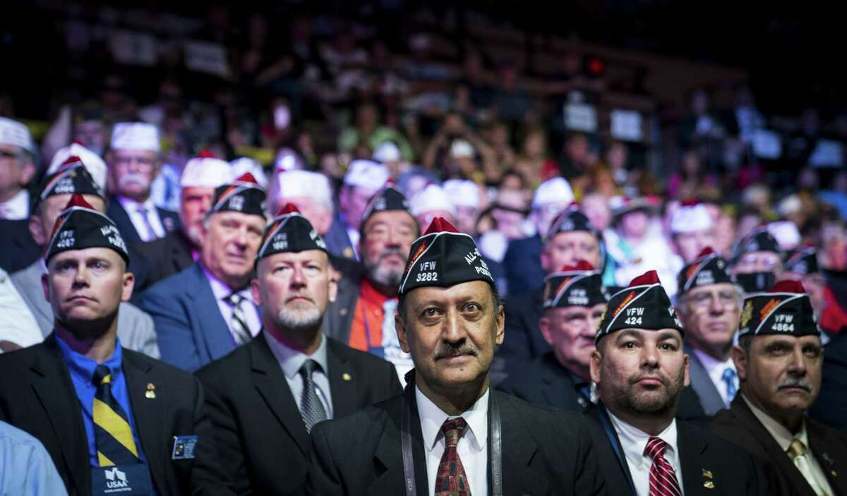 FILE -- Members look on as President Donald Trump addresses the Veterans of Foreign Wars of the United States National Convention at the Kansas City Convention Center in Kansas City, Mo., July 24, 2018. The largest, older veterans' service organizations see their influence diluted as newer, smaller groups focused on post-9/11 veterans compete for money, influence and relevance. (Doug Mills/The New York Times)
