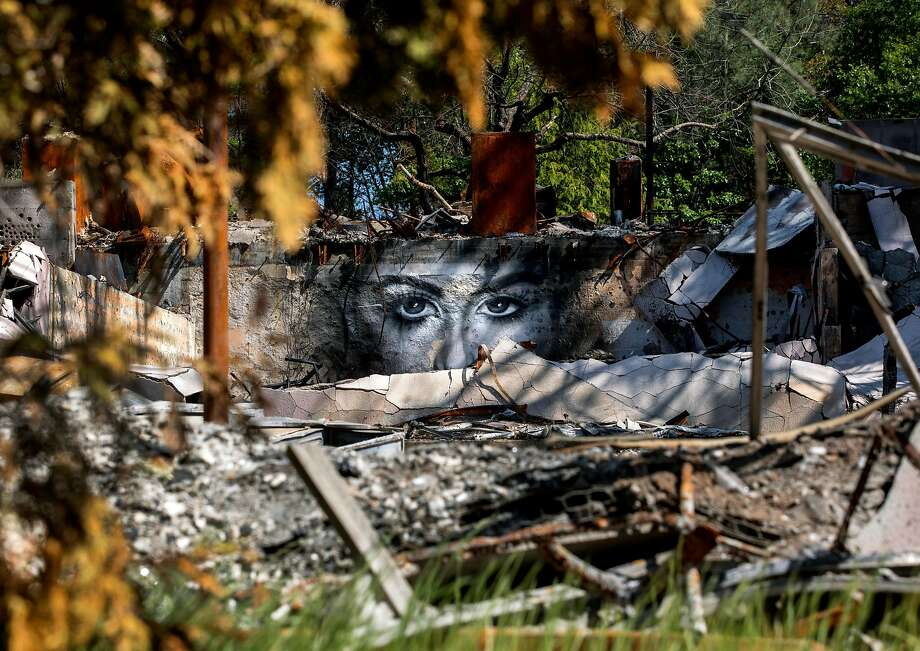 A Grammer mural on the wreckage of Seventh-day Adventist Church in Paradise. Photo: Jessica Christian / The Chronicle