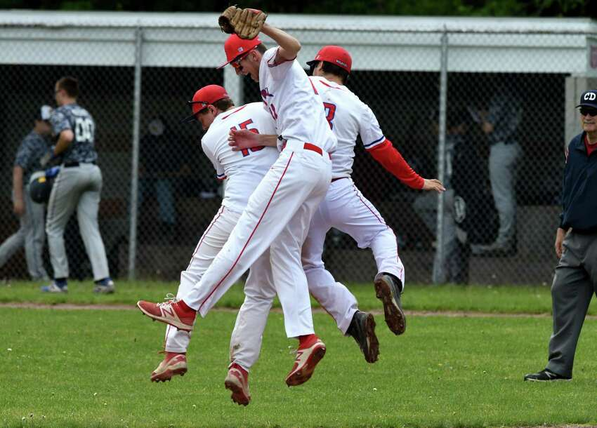 Maple Hill baseball players; Erick Burns, Quinn Pratico and James Miller, right, celebrate their win over Warrensburg during a Class C playoff game on Friday, May 24, 2019, at Maple Hill High School in Schodack, N.Y. (Will Waldron/Times Union)
