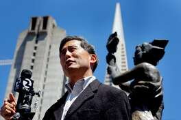 Doug Chan, Vice Chairman of San Francisco Human Rights Commission addresses the media under the Goddess of Democracy, to denounce the negative campaign attacks by other candidates against Mayor Ed Lee, Wed. August 10, 2011, the Portsmonth Square in San Francisco, Calif.