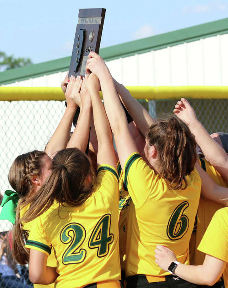 The Southwestern Piasa Birds holds a Class 2A regional championship plaque over their heads after beating Marquette Catholic last Friday in Piasa. The Birds are hoping to hoist another plaque Saturday when they play Hillsboro for the title of the Litchfield Sectional. Photo: Greg Shashack / The Telegraph