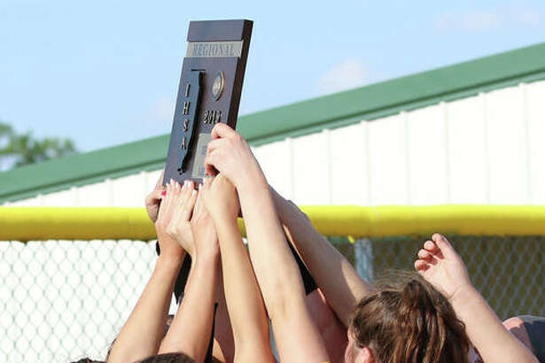 The Southwestern Piasa Birds holds a Class 2A regional championship plaque over their heads after beating Marquette Catholic last Friday in Piasa. The Birds are hoping to hoist another plaque Saturday when they play Hillsboro for the title of the Litchfield Sectional.