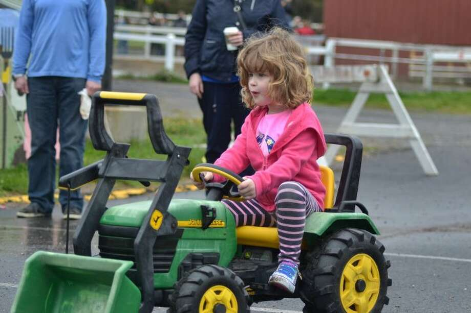 Five-year-old Clair Lidington rides a Tractor at the Agriscience Biotechnology Center's Farm Fair and Mother's Day Plant Sale — Lisa Romanchick photo