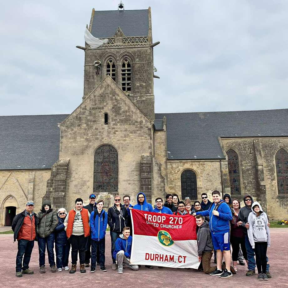 Members of Durham's Boy Scout Troop 270 traveled to the Trans-Atlantic Council's 75th anniversary of D-Day in April. They are shown here at at Sainte-Mere-Eglise. Photo: Contributed Photo