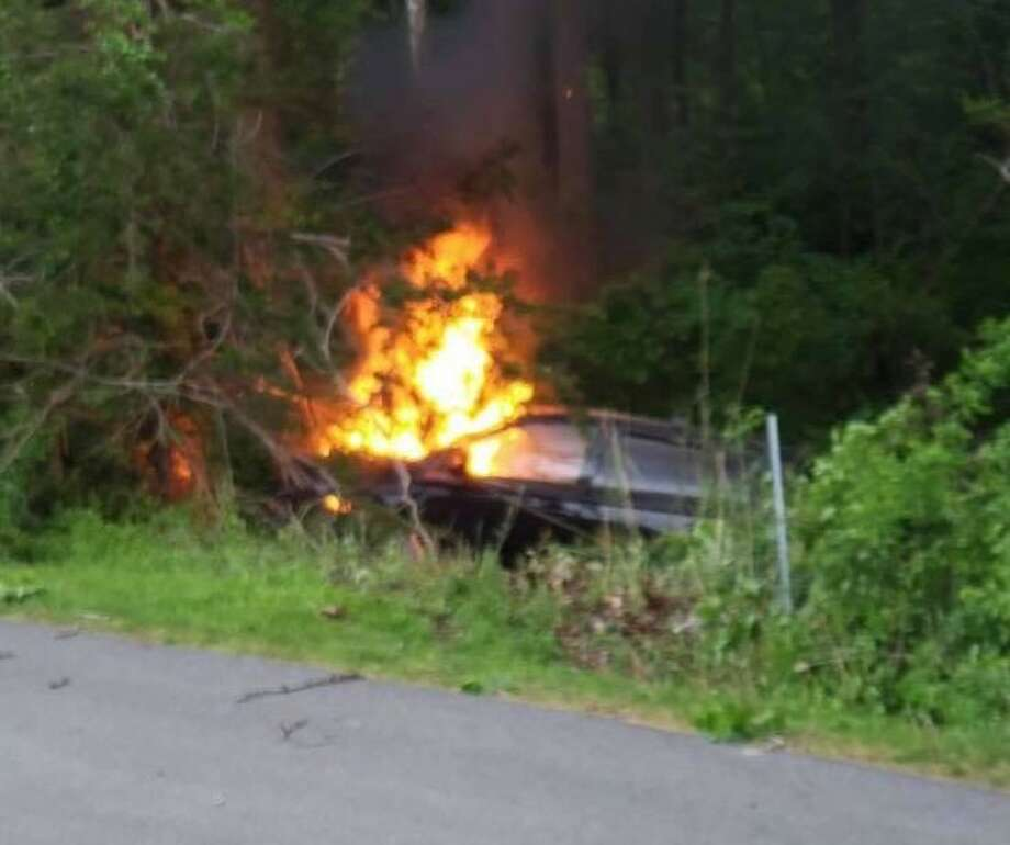 A vehicle crashed on Federal Road and caught fire with someone trapped inside the morning of Tuesday, May 21, 2019. Photo: Brookfield Volunteer Fire Company / Facebook