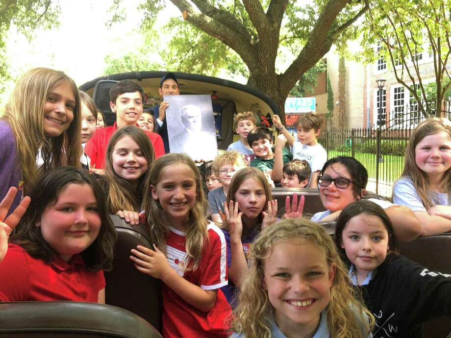 Houston Historical Foundation is a new nonprofit focused on educating Houston's young people about history and preservation. On Monday, May 20, Founder and Board Chairman R.W. McKinney, more popularly known as Mister McKinney, leads students from Ms. Raleigh Fitzpatrick's fourth grade class at Harvard Elementary School on a bus tour of their neighborhood, the Heights. Photo: Tracy Maness / Staff Photo