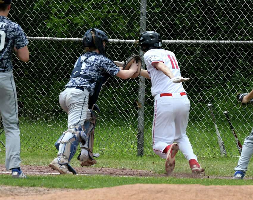 Quinn Pratico from Maple Hill is tagged out at home plate by Warrensburg catcher Zach Carpenter during a Class C playoff game on Friday, May 24, 2019, at Maple Hill High School in Schodack, N.Y. (Will Waldron/Times Union)