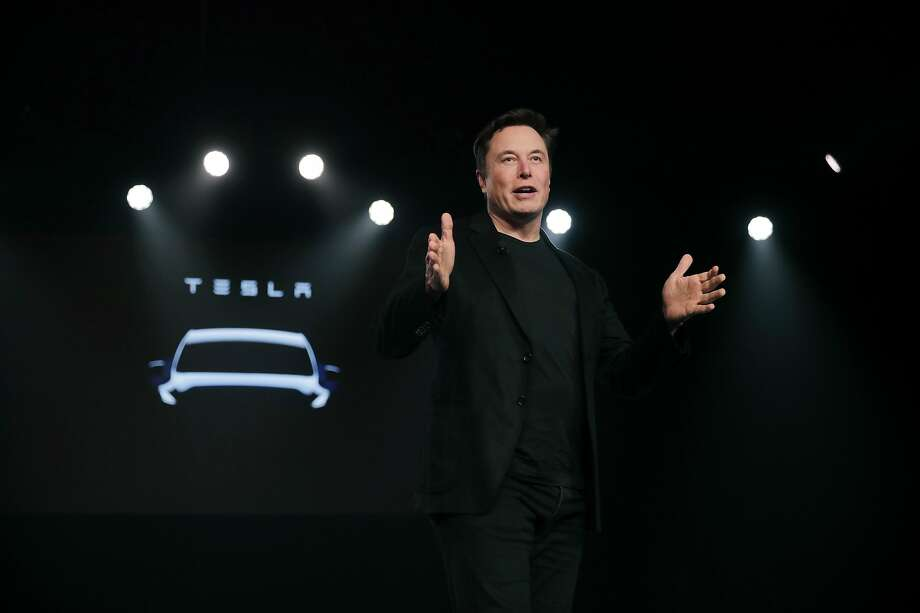 Tesla CEO Elon Musk speaks before unveiling the Model Y in March. He gave few details about the midsize SUV, though, and investors were not overwhelmingly supportive. Photo: Jae C. Hong / Associated Press