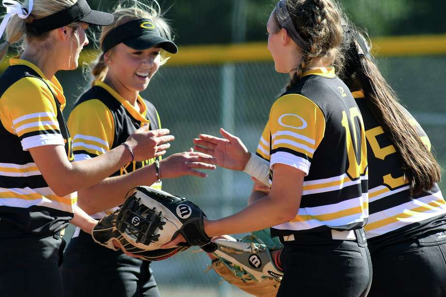 Klein Oak 2nd baseman Allie Saville, center, is all smiles with teammates Paige Hulsey, left, Bailey Eggleston (10) and Eryn Sanchez (55) as they get ready to go to work in the bottom of the third inning against Klein with a 10-2 lead over the Lady Bearkats in their District 15-6A play-in game at Klein Cain High School on April 19, 2019. Photo: Jerry Baker, Houston Chronicle / Contributor / Houston Chronicle