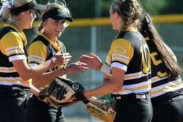 Klein Oak 2nd baseman Allie Saville, center, is all smiles with teammates Paige Hulsey, left, Bailey Eggleston (10) and Eryn Sanchez (55) as they get ready to go to work in the bottom of the third inning against Klein with a 10-2 lead over the Lady Bearkats in their District 15-6A play-in game at Klein Cain High School on April 19, 2019.