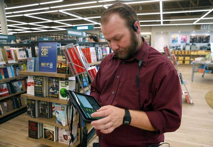 Employee Nate Emmett checks the store's inventory using a tablet at a new Barnes and Noble bookstore in Concord, Calif. on Friday, May 24, 2019. The store, which opened Wednesday, has new features which includes the tablets that the national chain is implementing.
