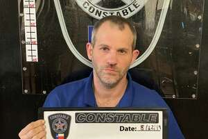 Seen in this photo taken by Montgomery County Precinct 4 Constable's Office deputies after apprehension, Michael Shane Emmons, 41, of Porter, is being charged with four felony counts of child pornography possession.