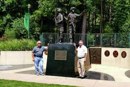 Everett Ison, rresident, and Bill Wingo, treasurer of the Greater Woodlands Public Art Foundation, stand at the statue.