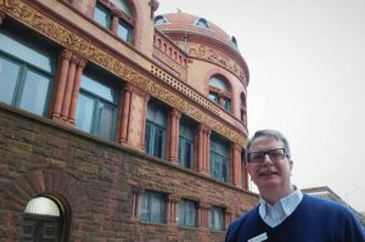 John Swing, Barnum Museum assistant director, stands outside the museum where PechaKucha Night took place March 21.