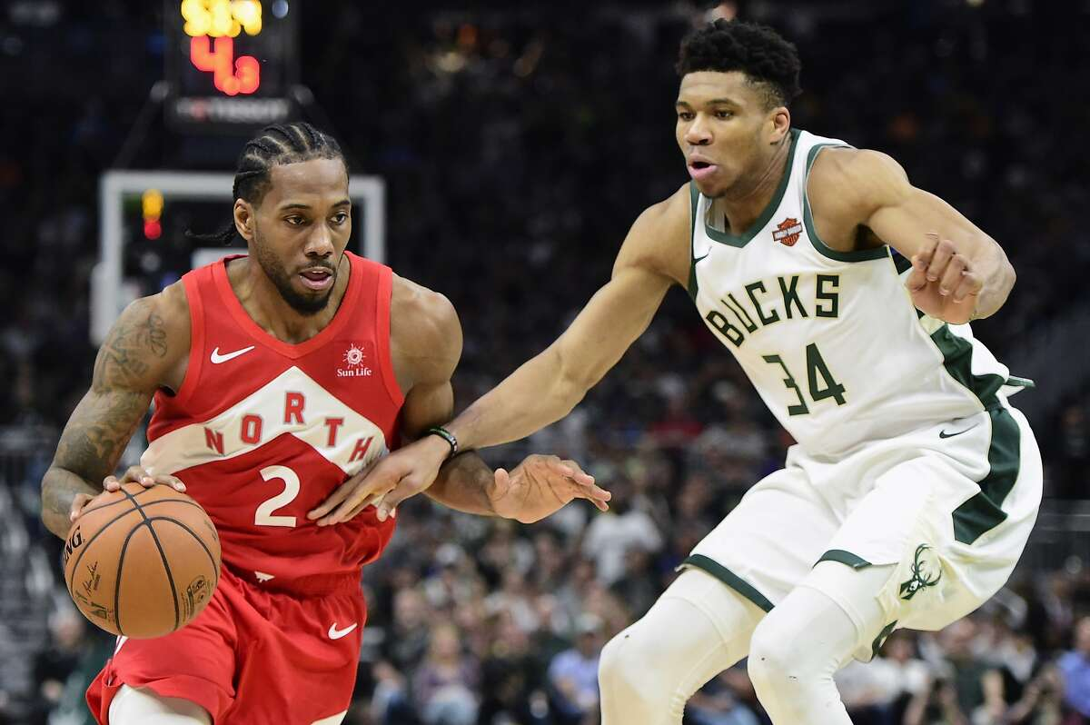 Toronto Raptors forward Kawhi Leonard (2) drives against Milwaukee Bucks forward Giannis Antetokounmpo (34) during the second half of Game 5 of the NBA basketball playoffs Eastern Conference finals in Milwaukee on Thursday, May 23, 2019. (Frank Gunn/The Canadian Press via AP)