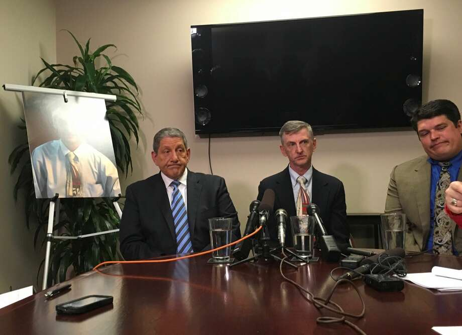 Eric Bishop (middle) is flanked by his attorneys Lawrence Kahn (left) and Brian Sullivan (right) at a news conference announcing the settlement and his story. Photo: Alex Halverson/SeattlePI