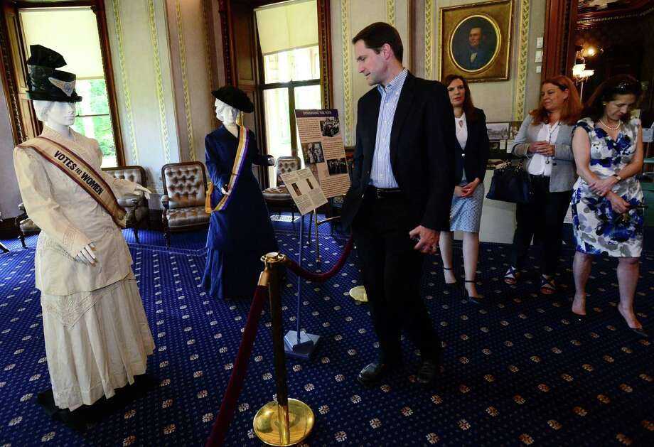 U.S. Rep. Jim Himes, D-Conn., joins state reps. Lucy Dathan, D-New Canaan, and Gail Lavielle, R-Wilton, as Lockwood Mathews Mansion Museum Executive Director Susan Gilgore, second from left, gives a special tour of their new exhibit, From Corsets to Suffrage: Victorian Women Trailblazers on Friday. Photo: Erik Trautmann / Hearst Connecticut Media / Norwalk Hour