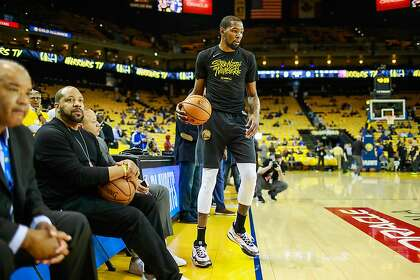 a004162eb Kevin Durant warms up ahead of Game 5 of the Western Conference Semifinals  between the Golden State Warriors and the Houston Rockets at Oracle Arena  in ...