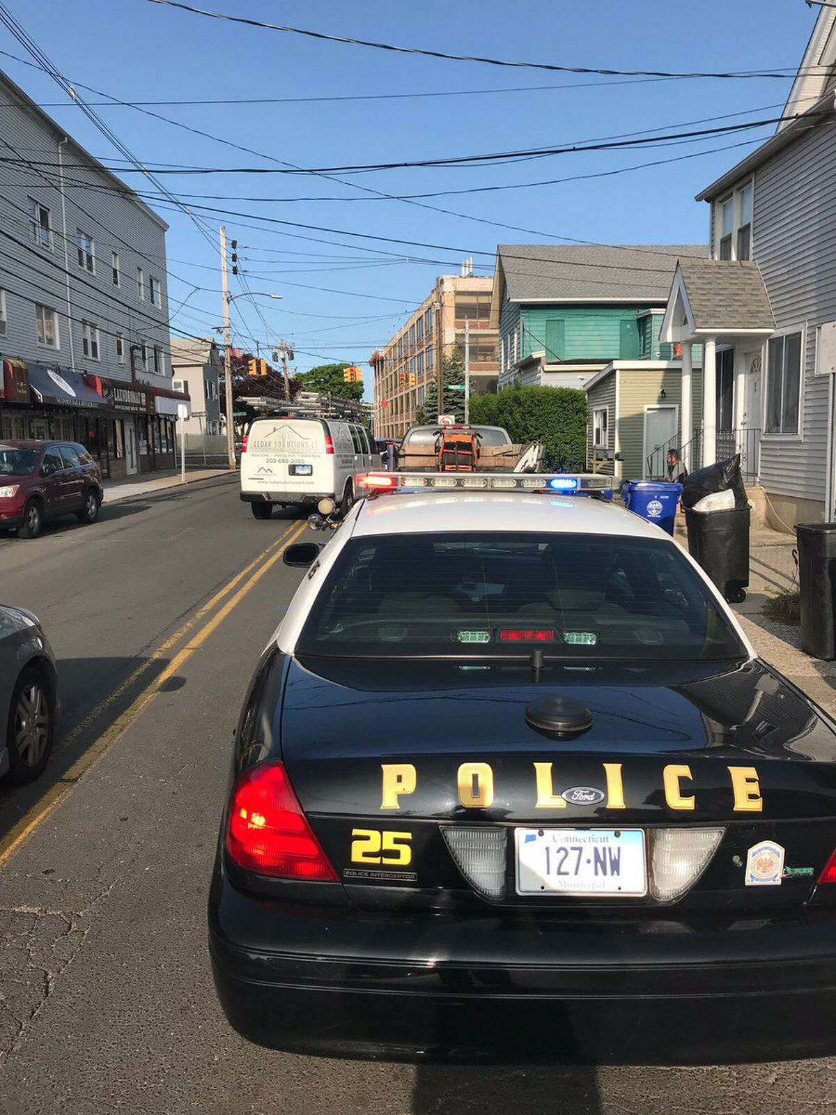 Norwalk police officers conduct a traffic stop in the city