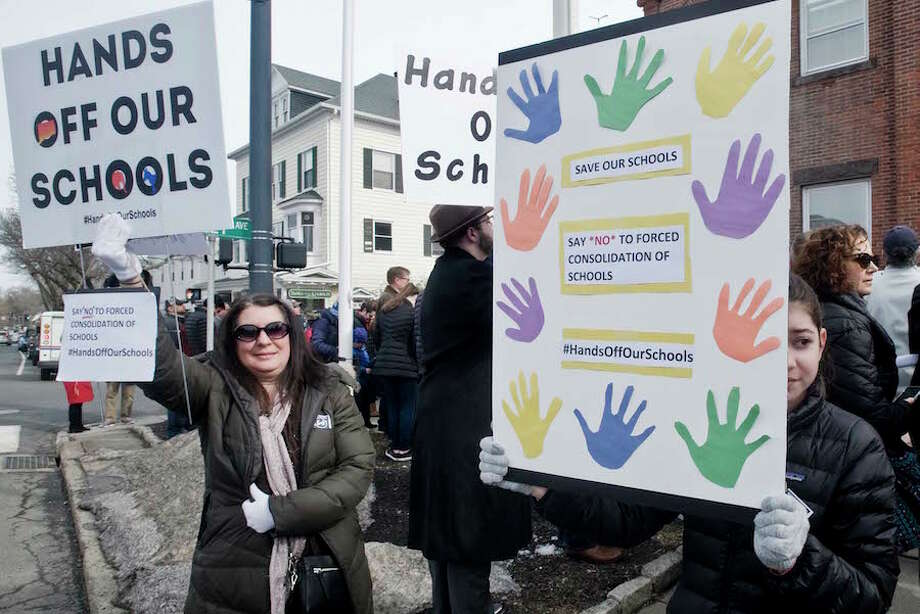 Lisa Sallese, and her daughter Daniella, 14 of Wilton, hold signs for the tarffic to see on Main Street at a rally against Senate Bill 454, held in front of Town Hall in Ridgefield. Saturday, Feb. 23. — Scott Mullin photo / The News-Times Freelance