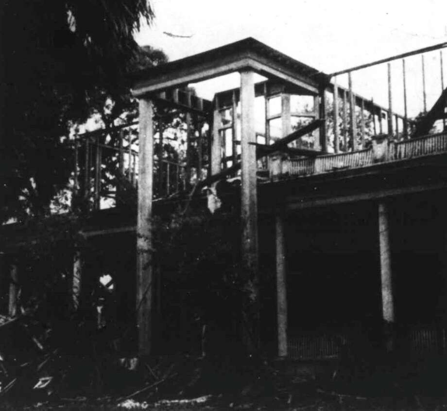 A bare skeleton of the second floor and the outside of the first floor are all that remained of the Crighton House in May 1964. It was on the corner of Main and Phillips streets. Photo: Courier File Photo