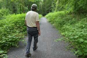 Norwalk River Valley Trail Executive Director Charlie Taney, walks along the Norwalk River Valley Trail through a slightly overgrown section of the Wilton Loop portion on Tuesday July 25, 2017 in Wilton Conn.