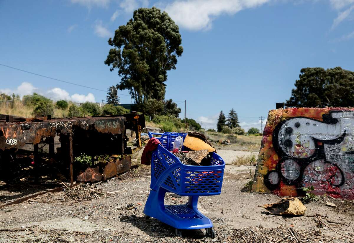 A grocery cart full of trash sits on the beach near the shoreline of Rodeo, Calif. Tuesday, May 21, 2019. An abandoned tugboat is seen in a cove near the shoreline of Rodeo, Calif. Tuesday, May 21, 2019.