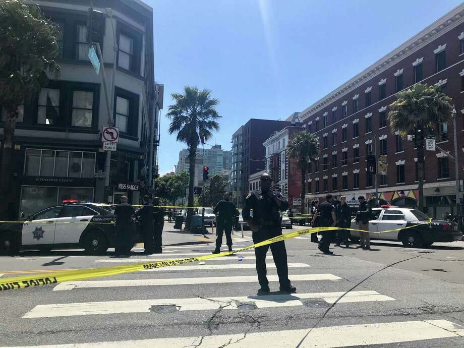 Police are investigating the shooting of two men at Sixth and Mission streets in San Francisco on Friday. Photo: Ashley McBride/SF Chronicle