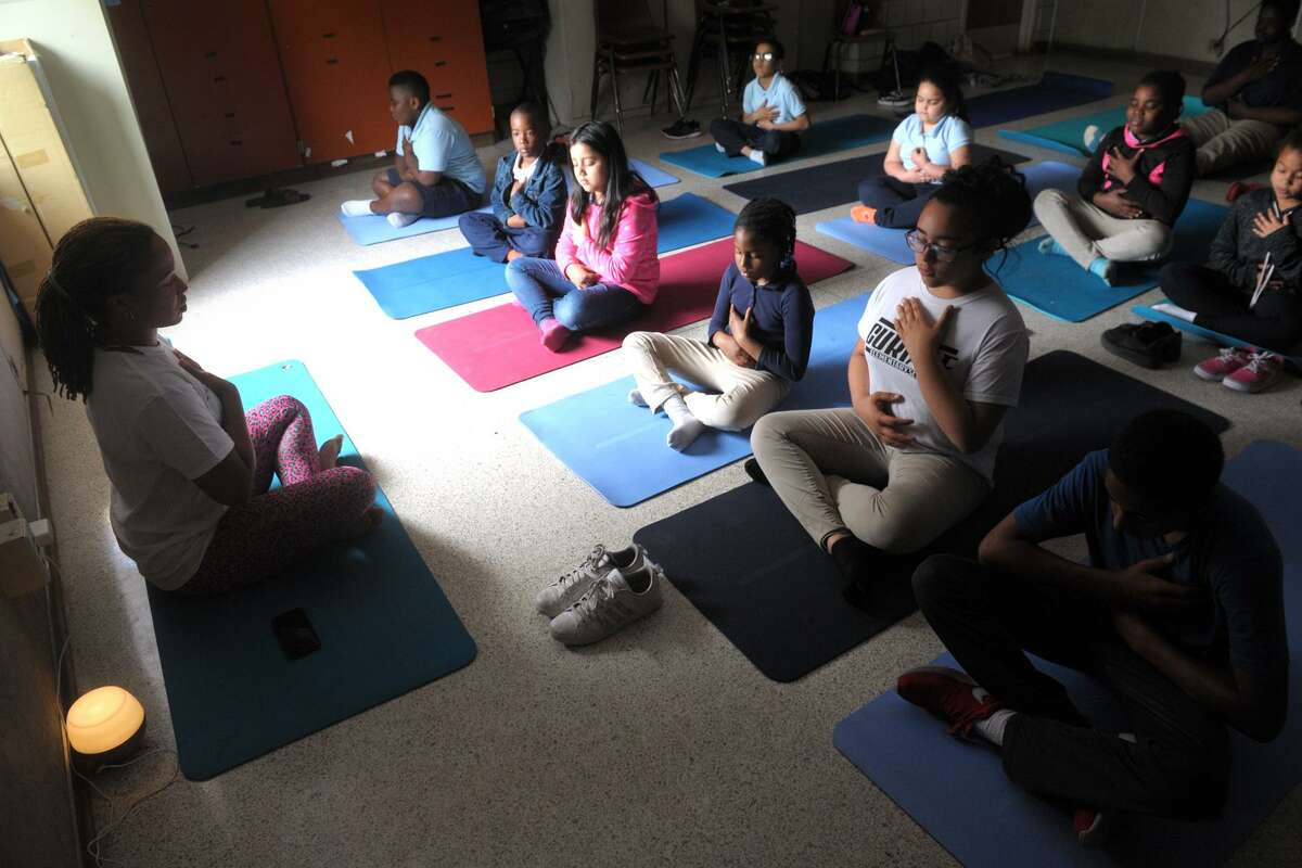 Students participate in a mindfulness meditation program at Curiale School, in Bridgeport, Conn. May 23, 2019.