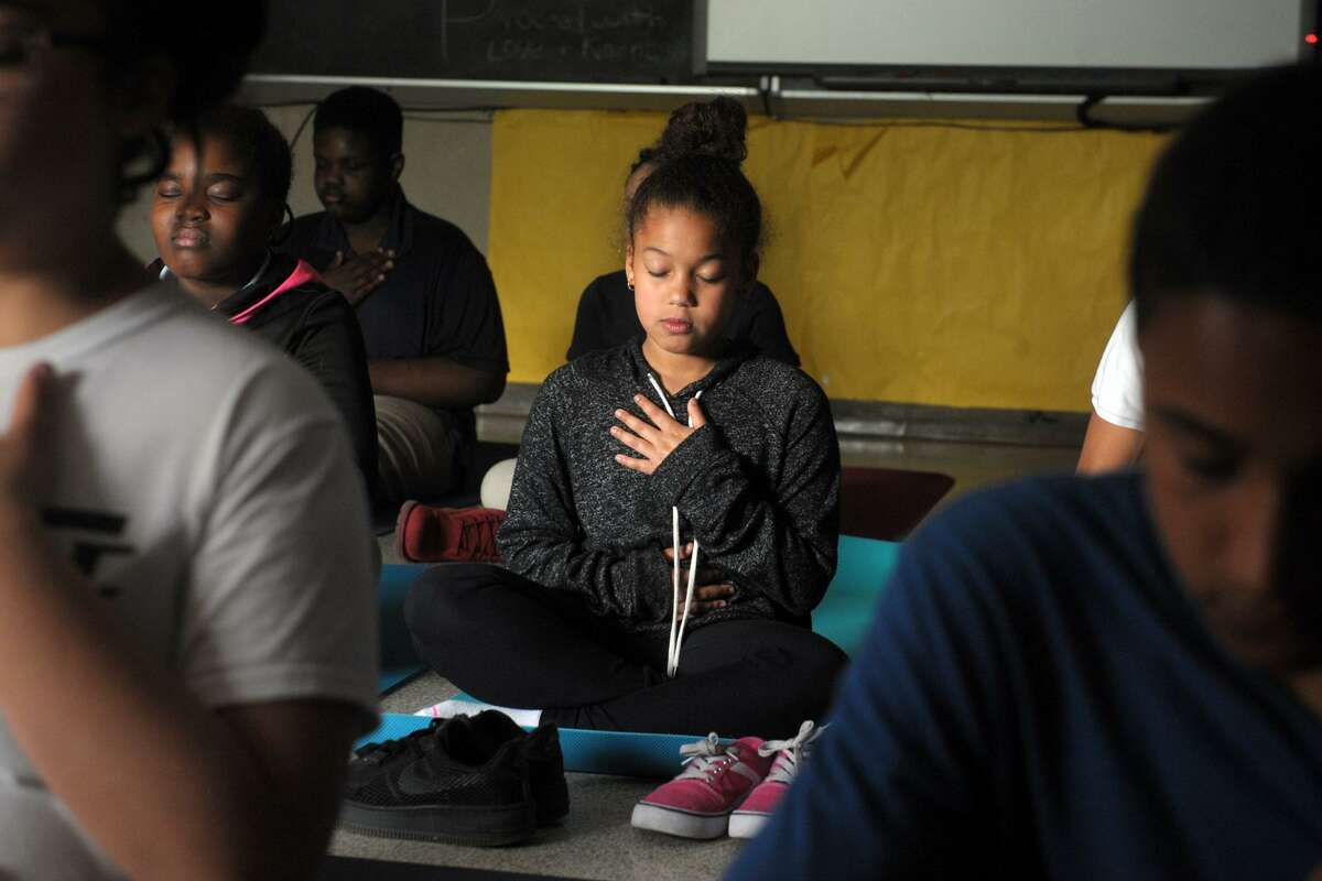 Fourth grader Ciara Sepulveda participates in a mindfulness meditation program at Curiale School, in Bridgeport, Conn. May 23, 2019.