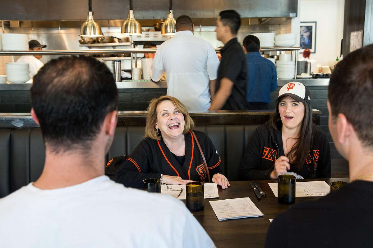 Jayne Carini, right, Marianne Carini, Bobby Carini , left and Michael Aicardi sit down fro lunch at The Brixton restaurant on Thursday before they head out to the San Francisco Giants game. May 23, 2019. San Francisco, Calif.