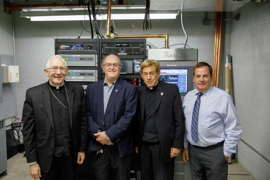 From left, Archbishop Leonard P. Blair; Tom Ray, WJMJ broadcast engineer; the Rev. John Gatzak, general manager of WJMJ Radio; and Michael Graziano, WJMJ chief engineer, in 2018. Photo: Contributed Photo