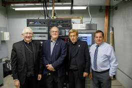 From left, Archbishop Leonard P. Blair; Tom Ray, WJMJ broadcast engineer; the Rev. John Gatzak, general manager of WJMJ Radio; and Michael Graziano, WJMJ chief engineer, in 2018.