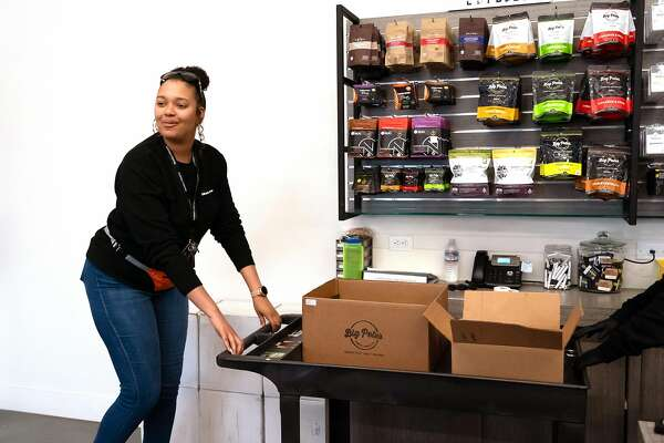 Co-owner Bri Moore with a cart of products at Blunts and Moore, a cannabis store under Oakland�s equity program, on Wednesday, May 22, 2019, in Oakland, Calif.