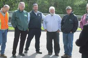 From left are Jim Rollins, Winsted Dept. Public Works, Robert Geiger, Winsted Town Manager, State Rep. Jay Case, State Sen. Craig Miner, and Charles Lee, DEEP, during a recent meeting at Highland Lake.