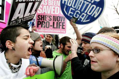 Pro-choice activists  argue in 2006 with Pro-life activists  on abortion issues in front of the U.S. Supreme Court in Washington, D.C.