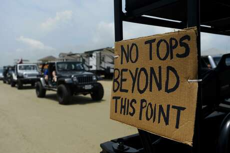 Jeeps cruise down the beach during the Go Topless Day for Jeep enthusiasts on Bolivar Peninsula.