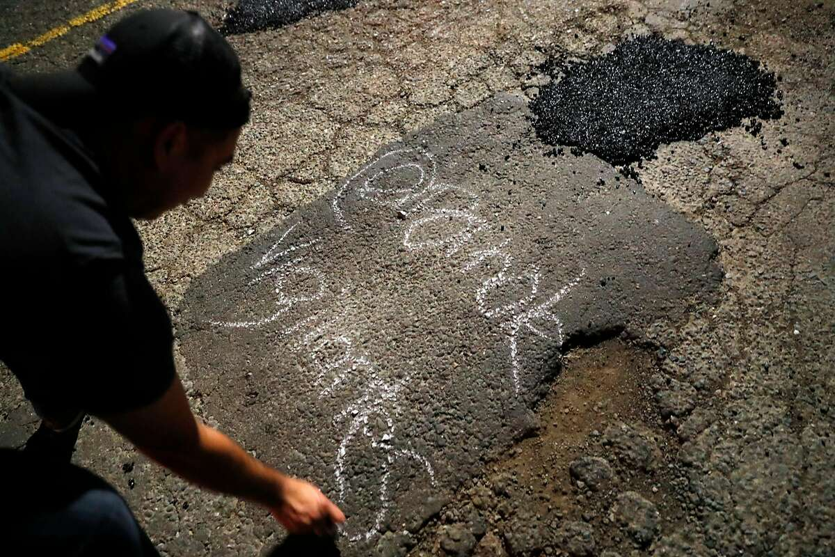 Brian writes @Pothole Vigilantes in chat;k after filling a pothole on Perkins Street in Oakland, Calif., on Wednesday, May 22, 2019.