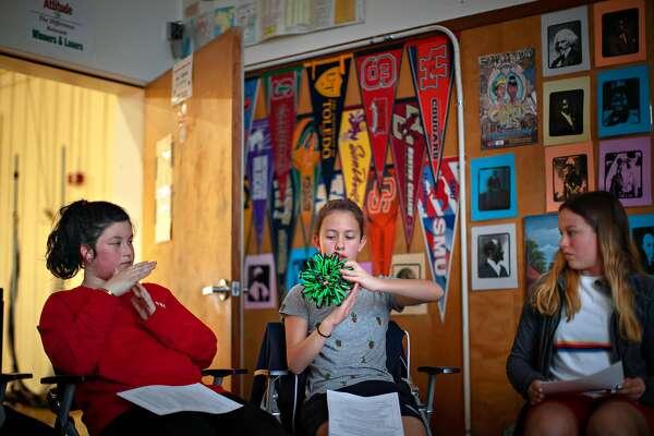 Josephine Mates-Muchin 12, Zoe Kushinova, 12, and Katrina Pimentel, 13, participate in the Restorative Justice program at Edna Brewer Middle School on Tuesday, April 23, 2019, in Oakland, Calif.
