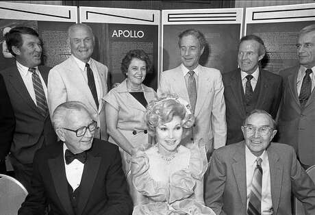 """Six of the original Mercury astronauts, and Gus Grissom's widow, Betty, reunite at the Charles A. Lindbergh Fund awards banquet on May 11, 1984, a party co-chaired by Joanne King Herring (front row, center). Back row, from left: Walter Schirra, John Glenn, Betty Grissom, Scott Carpenter, Gordon Cooper and Donald """"Deke"""" Slayton."""