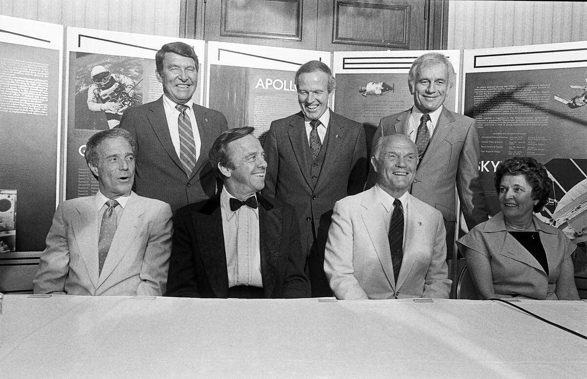 """Six of the original Mercury astronauts, and Gus Grissom's widow, Betty, reunite at the Charles A. Lindbergh Fund awards banquet in May 1984, a party co-chaired by Joanne King Herring. Standing, left to right: Walter Schirra, L. Gordon Cooper and Donald """"Deke"""" Slayton. Seated, left to right, Scott Carpenter, Alan Shepard, John Glenn and Betty Grissom."""