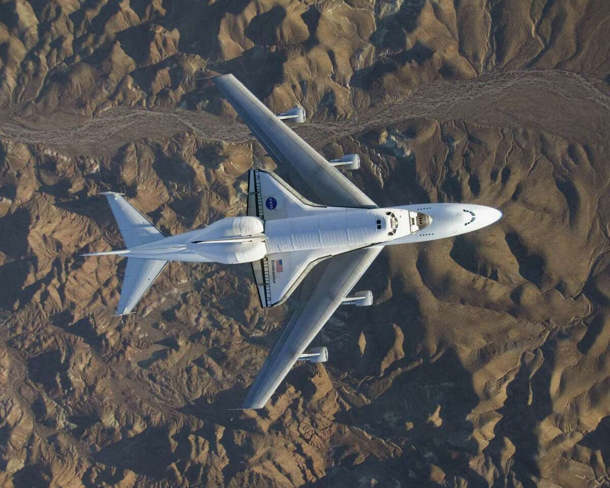 Pictured is the Boeing 747 carrier aircraft and the space shuttle Endeavour. Boeing has a long history in both aviation and space.