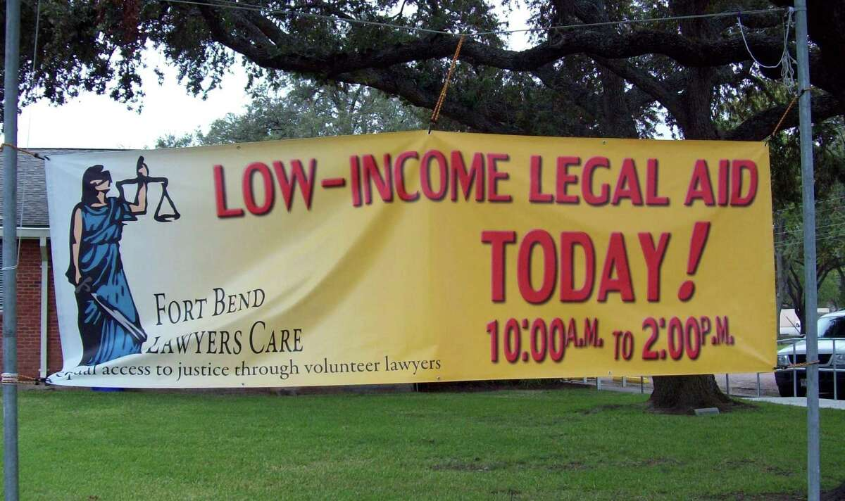 A banner trumpets the Low-Income Legal Aid Clinic held by Fort Bend Lawyers CARE each month in 2017. Unfortunately, the number of low-income residents who can't afford legal services dwarfs the number of lawyers available to help for free or at low cost. And then there's also the case of lower-middle class people who make too much to qualify for legal aid but not enough to pay a lawyer.