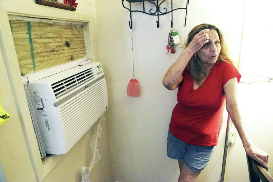 Delia Hewitty cools off May 7 as the San Antonio Housing Authority installs new air-conditioning units at the Pin Oak I apartments, a public housing complex. Yet other public housing lacks this necessity in San Antonio. Photo: Tom Reel /Staff Photographer / 2019 SAN ANTONIO EXPRESS-NEWS
