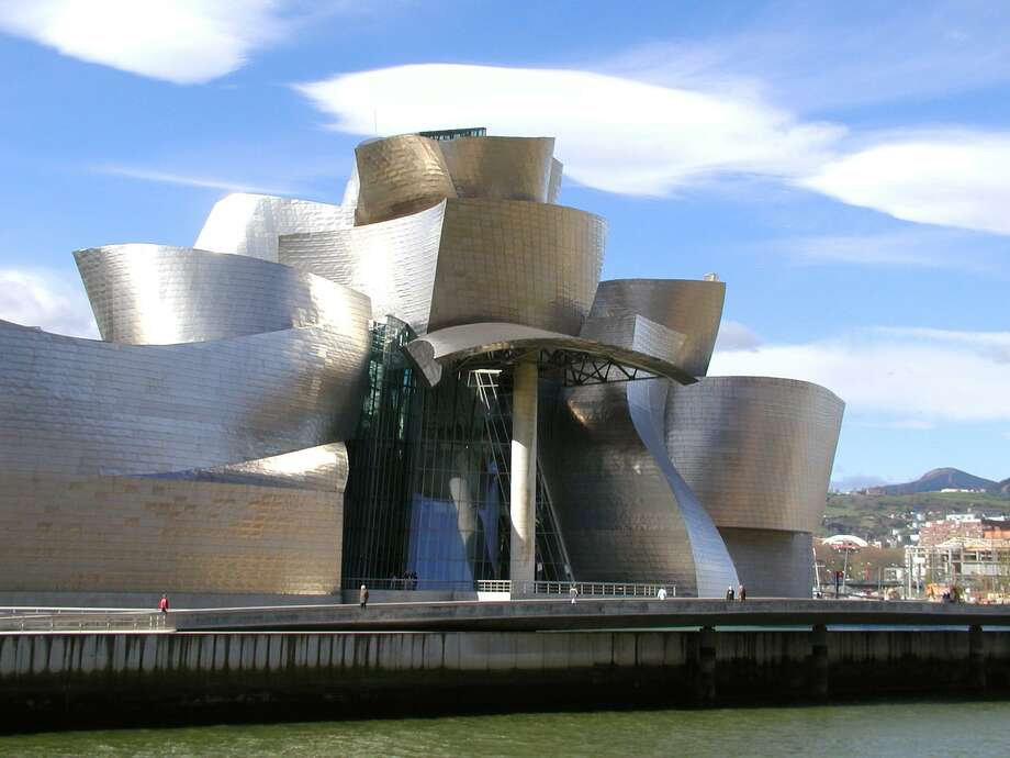 Guggenheim Bilbao in northern Spain is a glimmering, shimmering modern art museum. A reader is not pleased with a syndicated column about a recent show held at the Bilbao. Photo: Cameron Hewitt / / handout