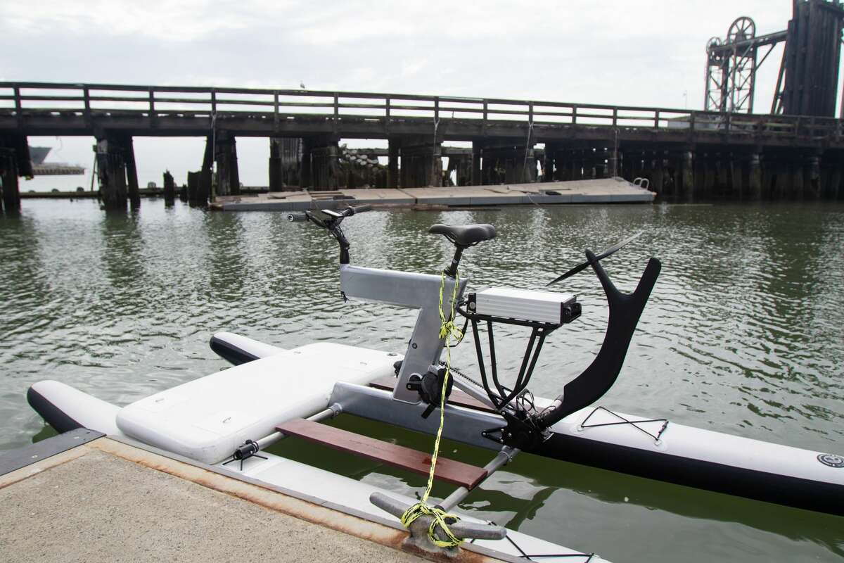 A look at the Schiller water bike, which is much like a regular bike mounted atop two pontoons. There's also an electric assist to make paddling easier.